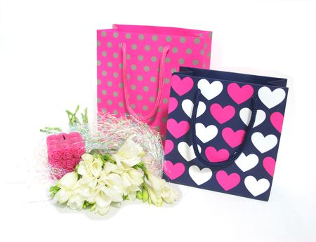 Gift bags and flowers for someones birthday or other special occasion photo