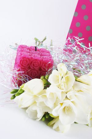 Flowers, candle and a gift bag for a birthday or other special occasion - isolated. Stock Photo - 875719