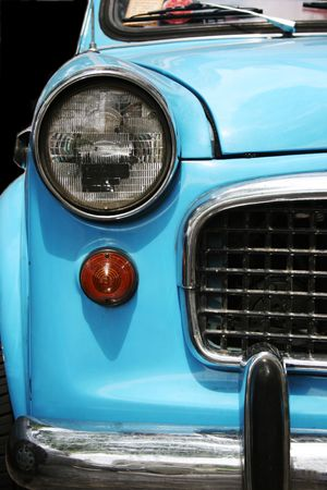 Close-up of the front of an old blue car
