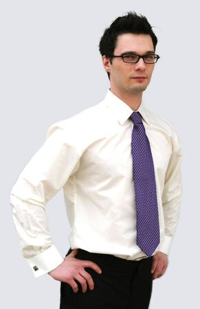 hooray: Confident business man in a white shirt and purple tie