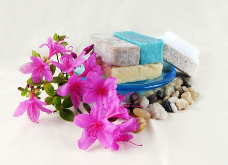 flecks: Soap and pumice stone at the day spa (background is linen so flecks are fabric texture, not dust or noise).
