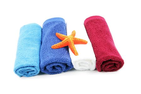 Colorful towels and orange starfish isolated on a white background photo