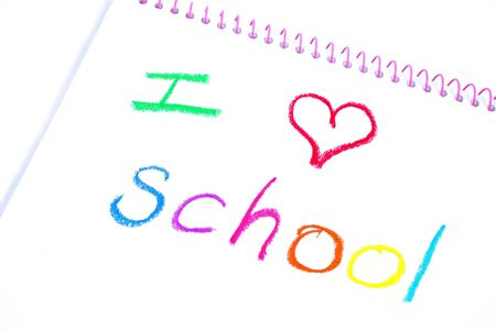 kindy: Notebook with the words I love school written in crayon