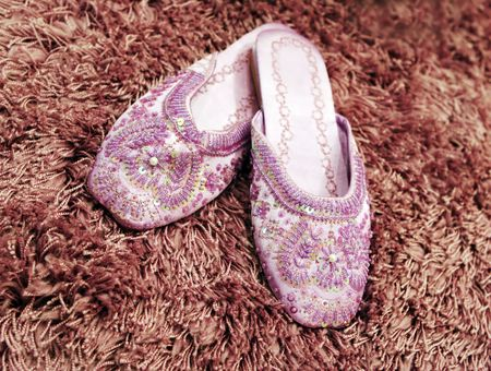 beaded: Pretty beaded slippers on thick wool carpet Stock Photo