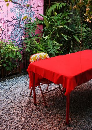 diningroom: Funky red garden chair and table.