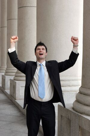 hooray: Young businessman throws his arms up in a gesture of success. Stock Photo