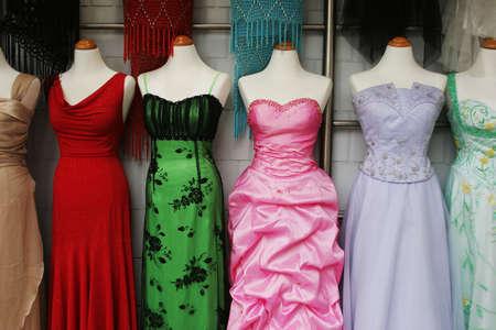 business dress: Mannequins wearing beautiful evening dresses.