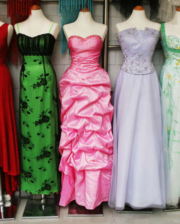 Mannequins wearing beautiful evening dresses. photo