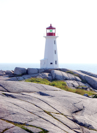 Lighthouse at Peggys Cove, Novia Scotia, Canada - travel and tourism. photo