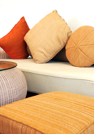 cane sofa: Sofa and chair in a modern house - home interiors.