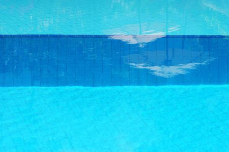 bronze background: Close-up of blue water in a swimming pool.