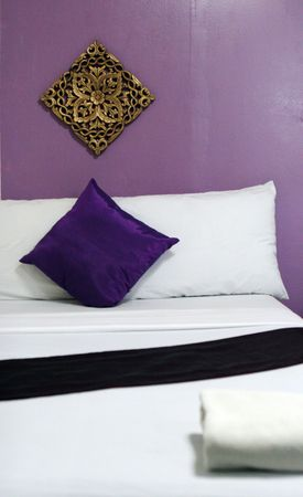 Purple and gold Asian bedroom interior. photo