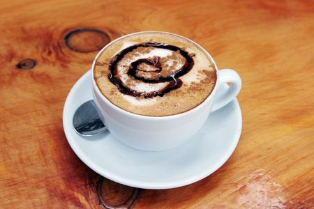 cuisine entertainment: Cup of delicious hot cafe latte. Stock Photo