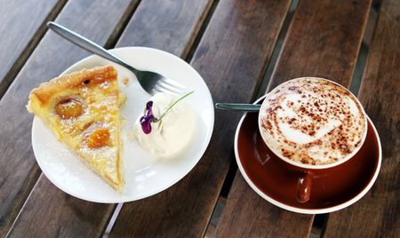 caffiene: Apricot pie and cream with a cafe latte.