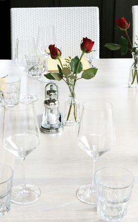 Elegant table setting with red roses and white linen. Stock Photo - 2229311