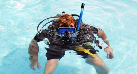 skindiver: Happy scuba diver in the swimming pool blowing bubbles. Stock Photo