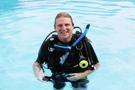 skindiver: Happy scuba diver in the swimming pool.