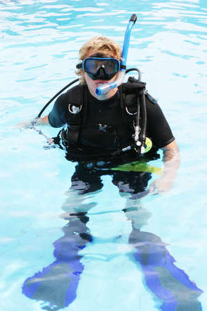 skindiver: Scuba diver in the swimming pool. Stock Photo