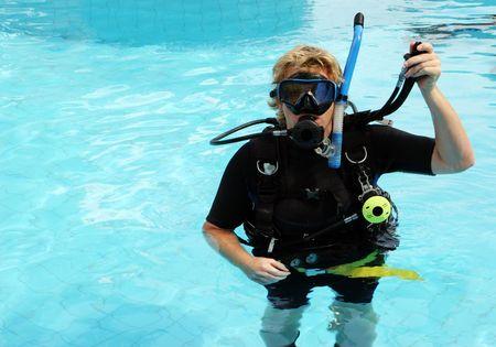 Scuba diver in the swimming pool. photo