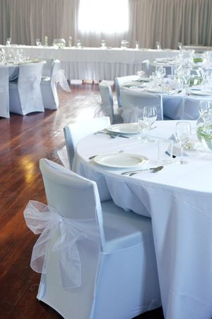 Tables decorated at a wedding reception.