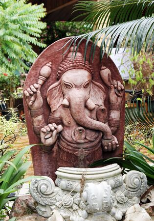 Thai stone carved Buddhist statue of an elephant - travel and tourism. photo