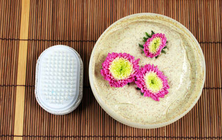 body scrub: Spa and beauty products - body scrub and brush.