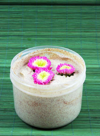 body scrub: Spa and beauty products - body scrub and flowers.