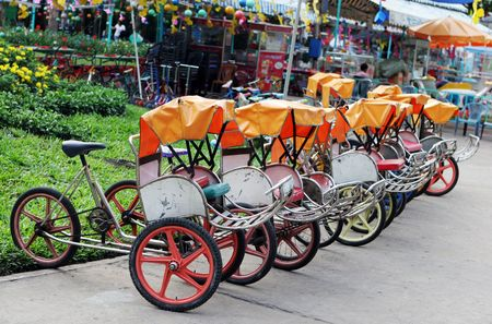 minature: Row of minature cyclos in Vietnam - travel and tourism.