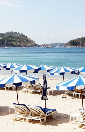 Blue and white beach umbrellas overlooking the sea. Stock Photo - 2735458