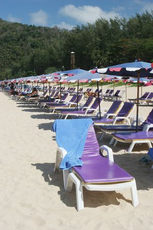 Rows of colorful beach chairs and umbrellas at the beach. Stock Photo - 2735672