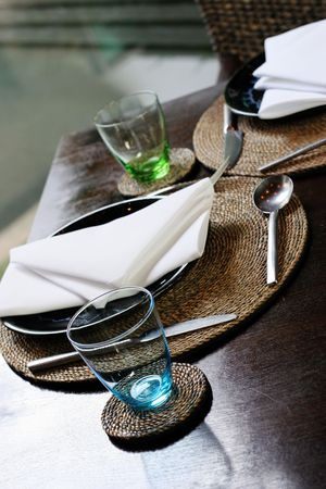 homeware: Colored glasses on a table in a modern home. Stock Photo