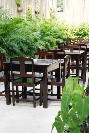 Table and chairs in an outdoor garden restaurant. photo