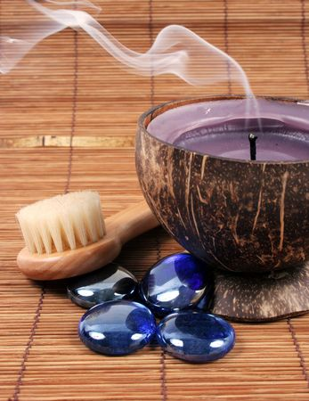 Spa and beauty products including a smoking candle. Stock Photo - 2901431