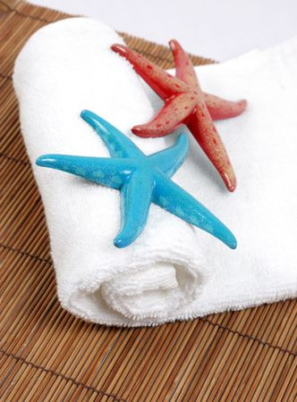 calmness: Colorful starfish on a white towel - spa and beauty.
