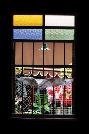 room accent: Window with stained glass accents - home interiors. Stock Photo