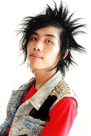 Portrait of an Asian guy with a punk hairstyle.