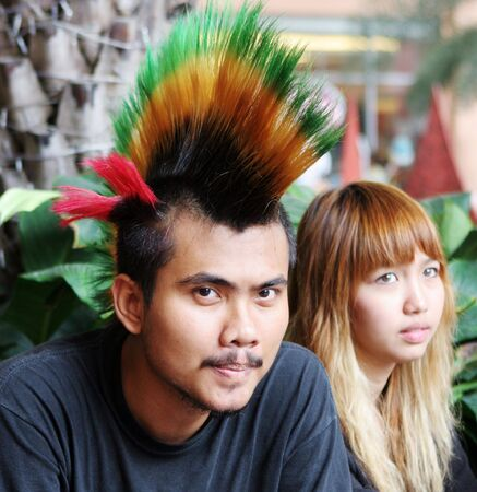 spikey: Punk with bright multi-colored mohawk. Stock Photo