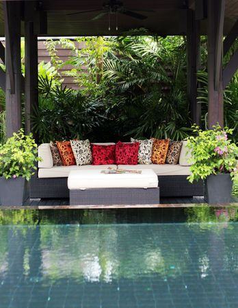 Outdoor seating area and swimming pool in a modern home.