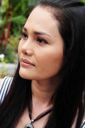 Close-up portrait of an attractive Thai woman. 스톡 콘텐츠