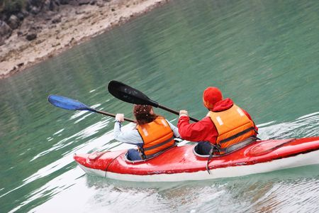 lifejacket: A man and woman head off on a kayaking trip - health and fitness.