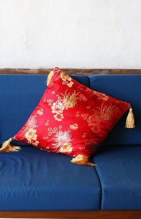 Red oriental cushion on a sofa - home interiors. photo
