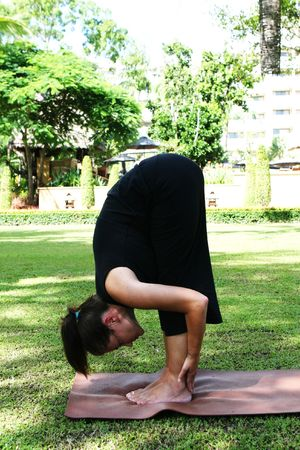Young woman practicing yoga in the park. Stock Photo - 3324236