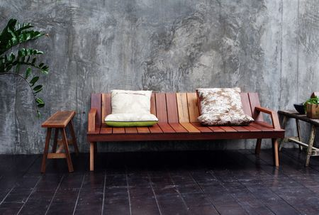 Wooden sofa and cushions in a modern interior. Stock Photo - 3436923
