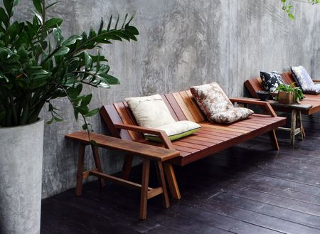 Wooden sofa and cushions in a modern interior. Stock Photo - 3436919