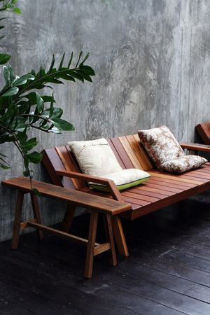 Wooden sofa and cushions in a modern interior. Stock Photo - 3436926