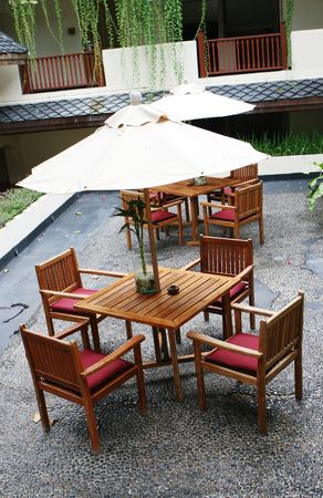 fine cane: Aerial shot of wooden table and chairs - garden furniture.