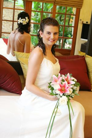 Beautiful young bride with a bouquet of flowers. photo