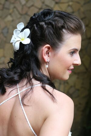 Beautiful young bride with flowers in her hair. Stock Photo - 3490771
