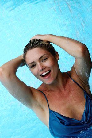 Beautiful blond woman in a swimming pool.