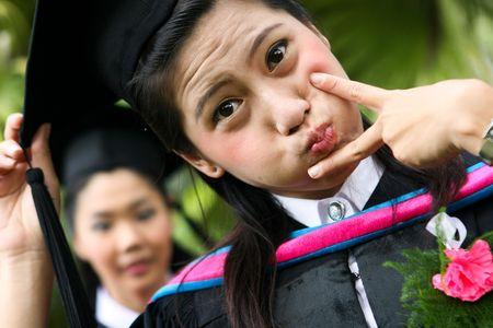 Gorgeous Asian university graduates celebrating their success. photo
